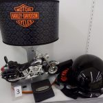 Harley-Davidson lamp, helmet, wallet and sunglasses.