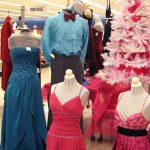 Junior department with prom dresses and clothes.