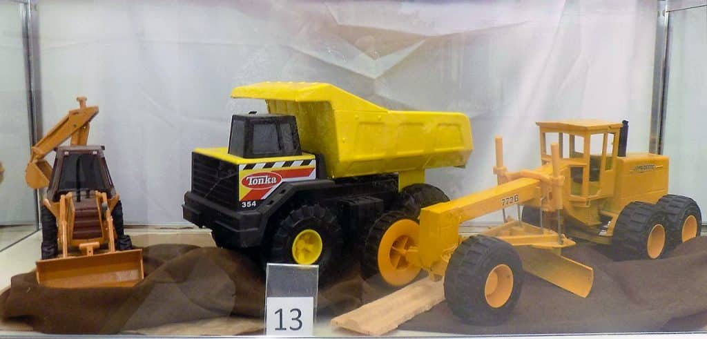 Die Cast construction vehicles including a Tonka truck.