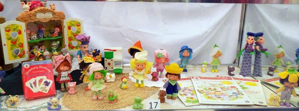 Fourteen vintage Strawberry Shortcake dolls and more