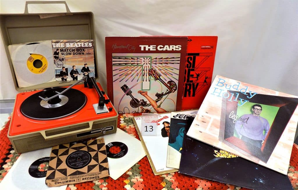 Vinyl records and record player including Buddy Holly, The Beatles, The Cars and more.