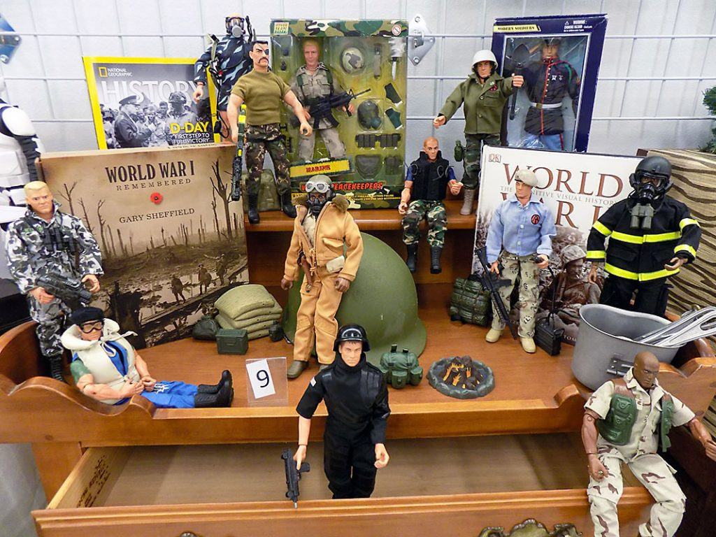 World War Memorabilia and GI Joe figurines.