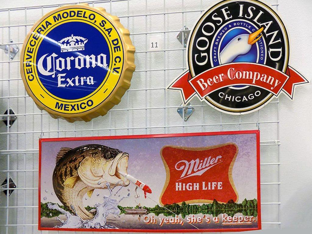 Corona, Goose Island and Miller High Life metal beer signs.