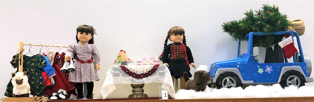 American Girl dolls in Christmas setup.