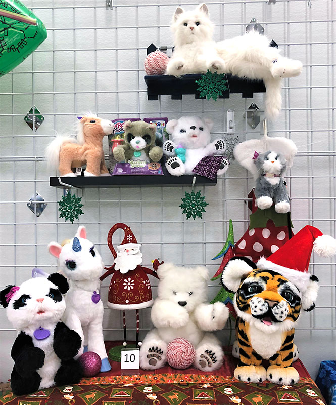 FurReal plush animals in Christmas setting.