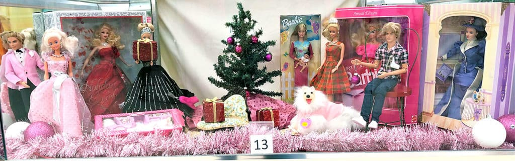 Barbie doll lot in Christmas sale display.