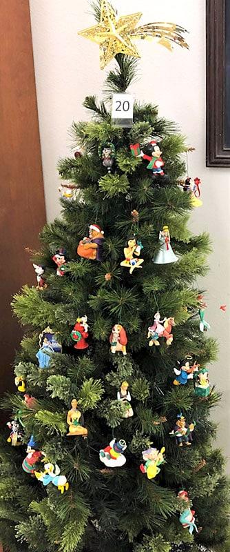 Disney ornaments on a Christmas tree.