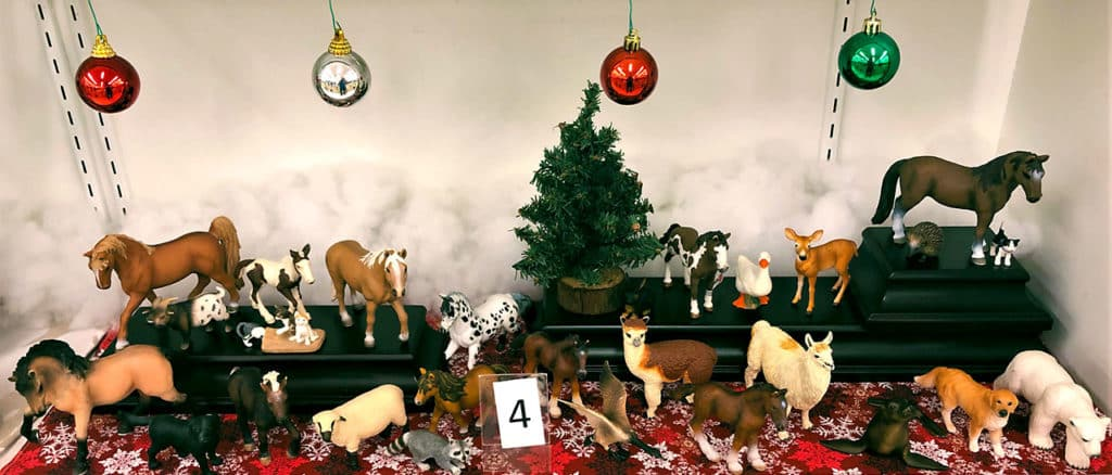 Schleich animal figure lot in Christmas setting.