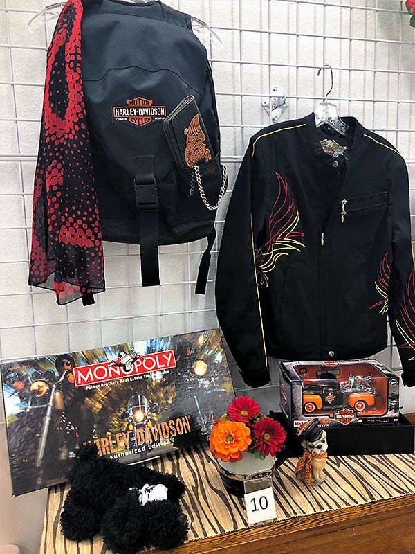 Harley Davidson jackets, Monopoly game and other collectibles.