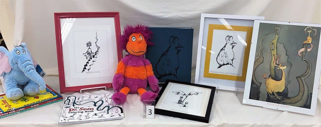 Dr. Seuss plush dolls, books and pictures in frames.