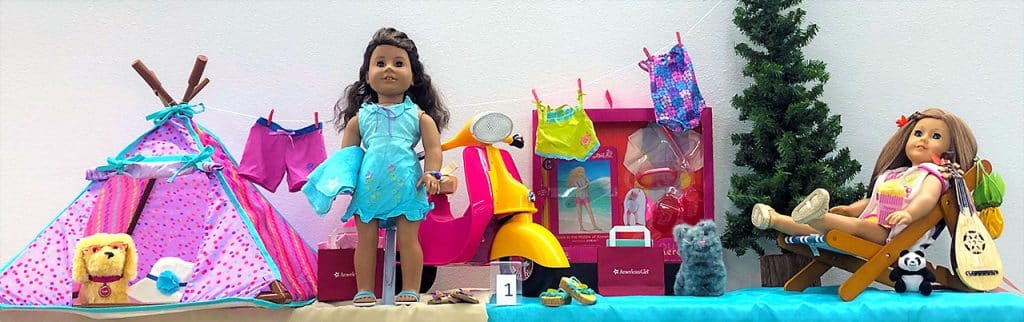 American Girl dolls with camping set.