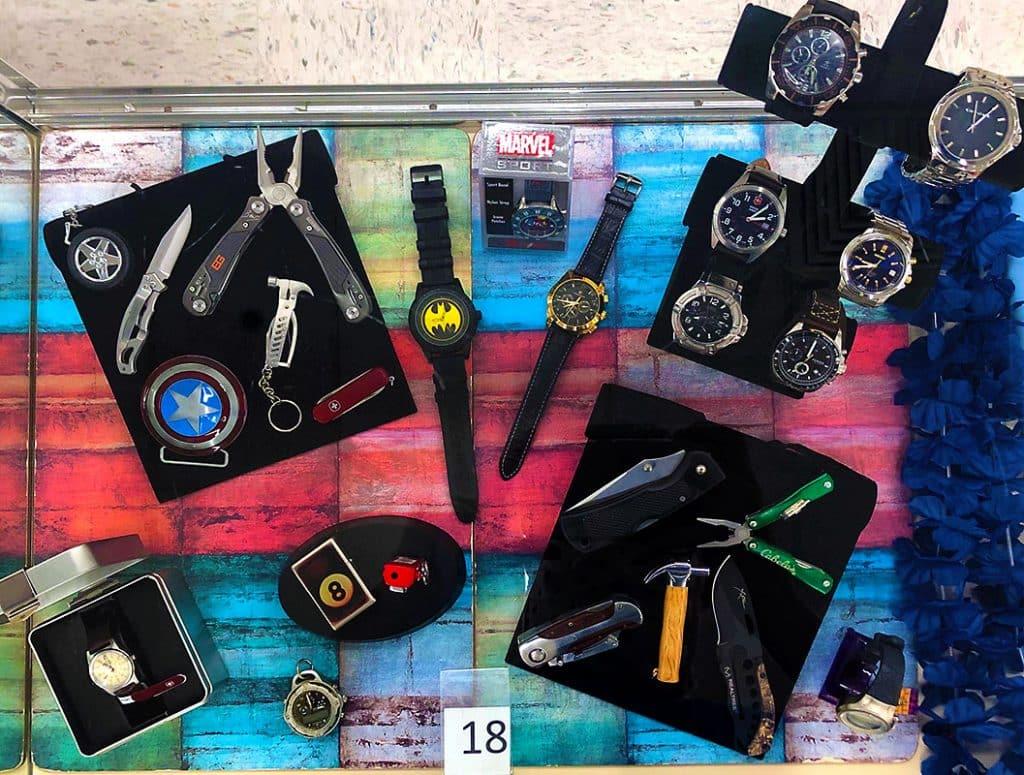 Men's watches, pocket tools and pocket knives.