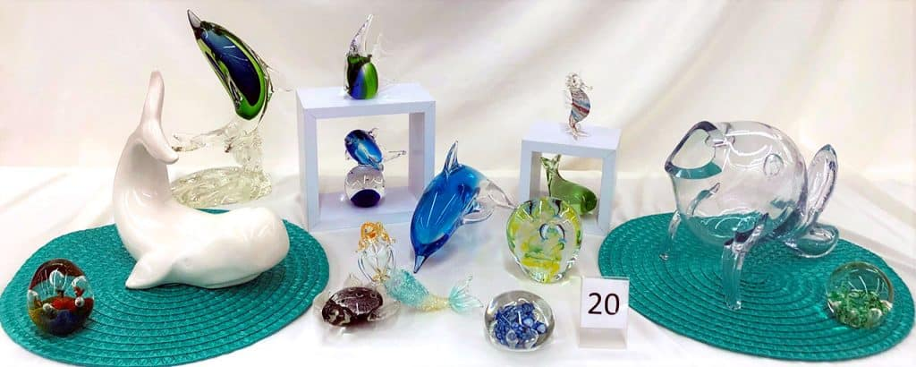 Glass dolphins, whales and other sea themed glass.