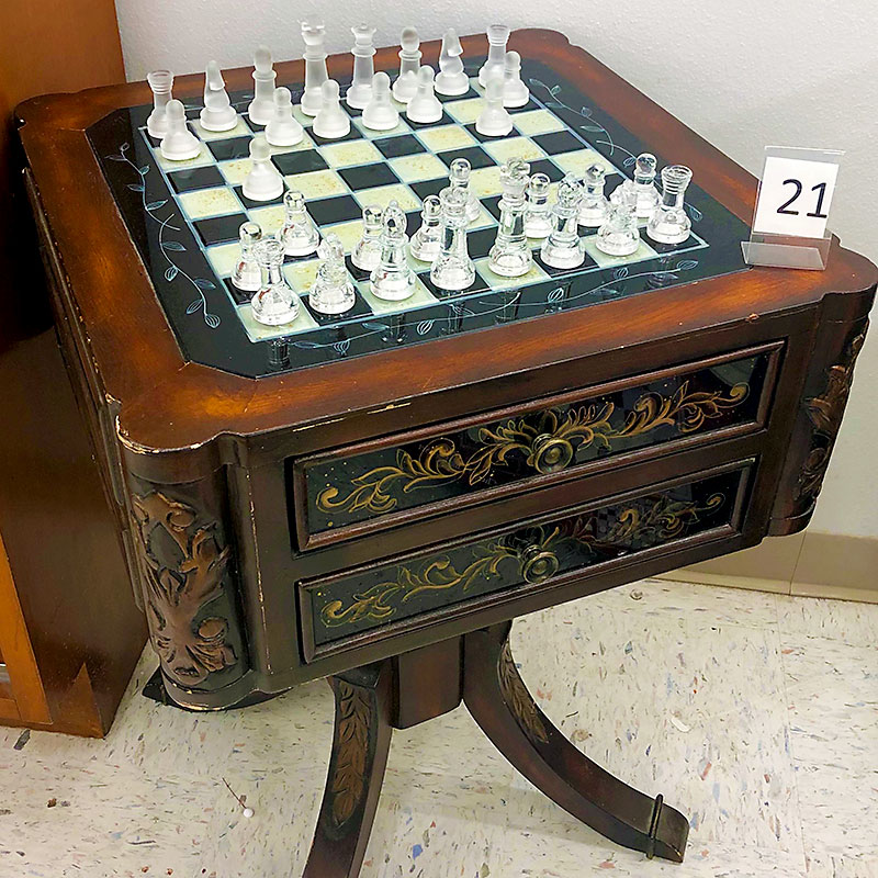 Glass table top chess set table.